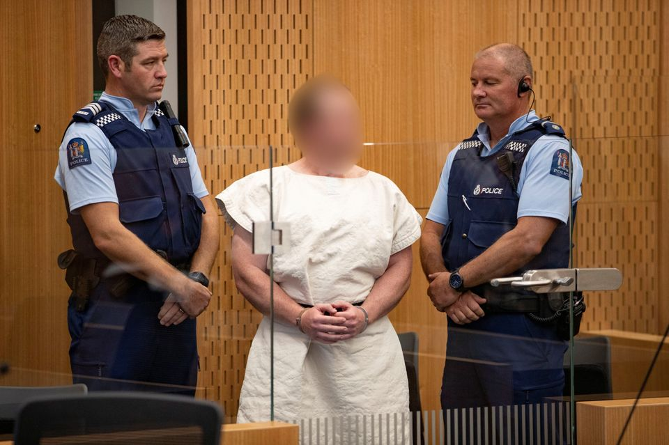 Brenton Tarrant, whose face is obscured here, is seen in the dock during his appearance in the Christchurch...