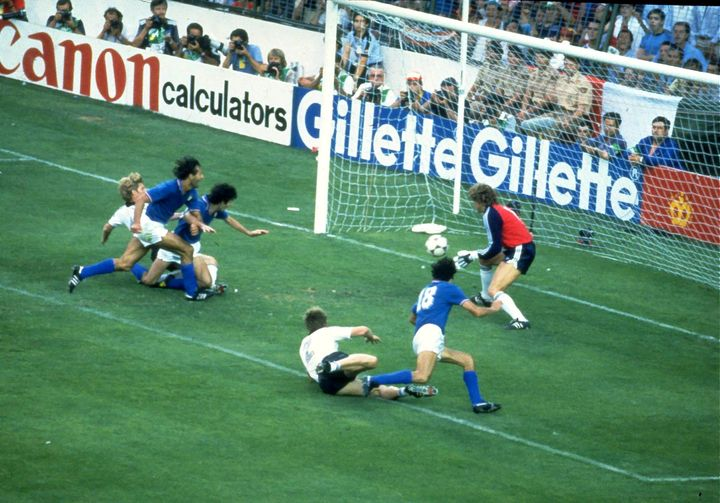 FILE PHOTO: Football - 1982 FIFA World Cup Final - Italy v West Germany - Estadio Santiago Bernabeu, Madrid - 11/7/82   Paolo Rossi scores a goal for Italy.   Mandatory Credit: Action Images/File Photo