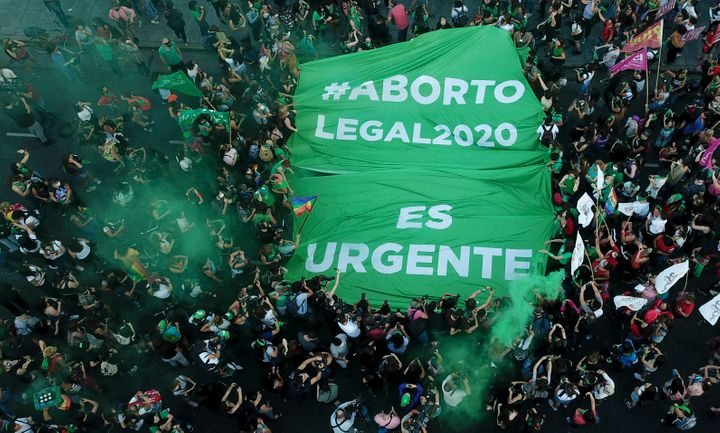 Abortion-rights activists in Argentina demonstrate in favor of decriminalizing abortion with a banner that reads in Spanish ""