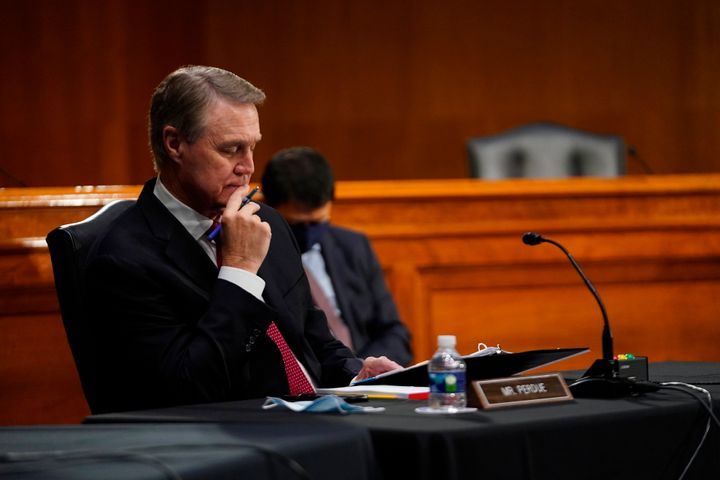 Sen. David Perdue listens during the Senate's Committee on Banking, Housing, and Urban Affairs hearing examining the quarterl