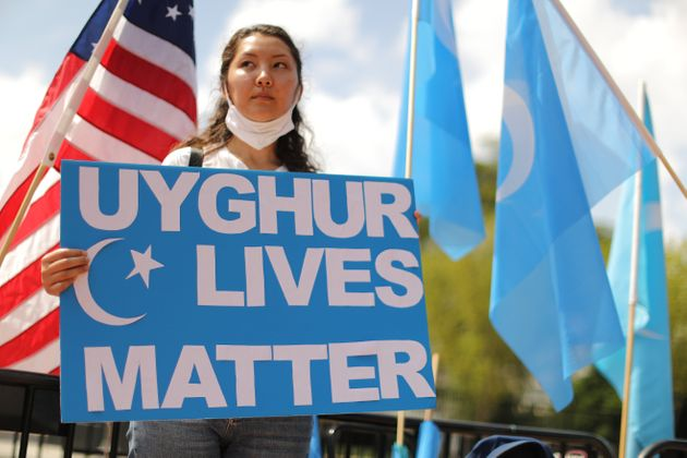 WASHINGTON, DC - AUGUST 14: Supporters and members of the East Turkistan National Awakening Movement...