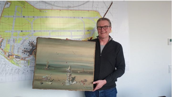 Chief Detective Michael Dietz of the Dussedorf Police Department holds a painting from French artist Yves Tanguy. A businessm