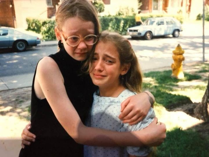 The writer, right, when she was about 12 years old.