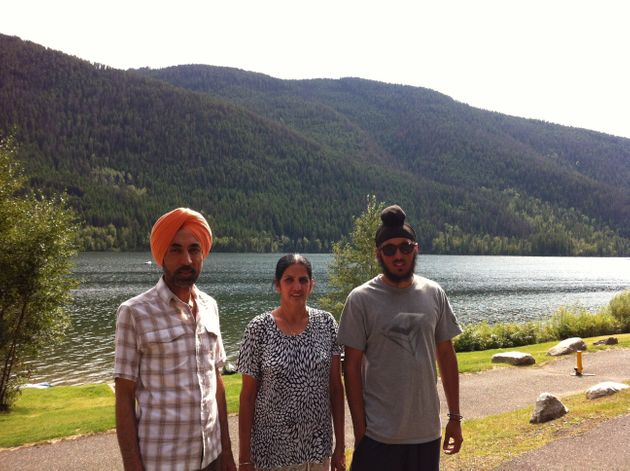 Peter Singh, right, with his parents Balvir and Harvinder on a walk at Paul Lake near Kamloops, B.C....