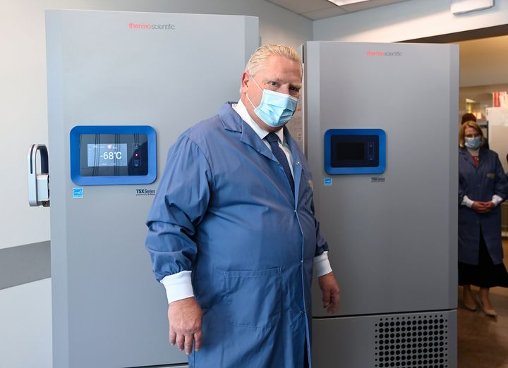 Ontario Premier Doug Ford looks at freezers ahead of COVID-19 vaccine distribution in Toronto on Dec. 8, 2020.