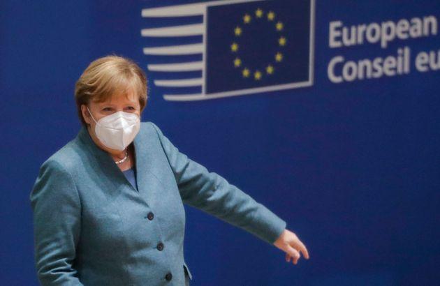 German Chancellor Angela Merkel attends a round table meeting at an EU summit at the European Council...
