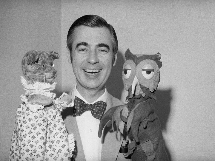 Fred Rogers, aka Mister Rogers, holds up two of his longtime neighbors, Henrietta Pussycat (left) and X the Owl.