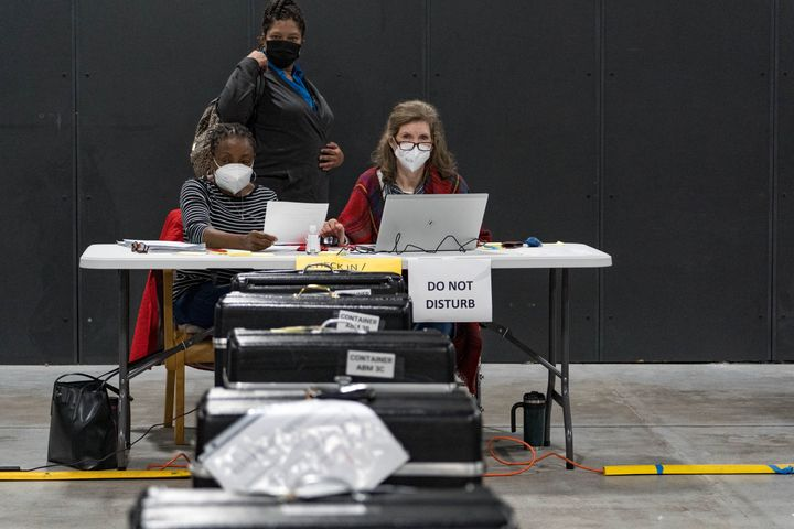 Gwinnett County election workers handle electronic ballots as part of the recount for the 2020 presidential election at the Beauty P. Baldwin Voter Registrations and Elections Building on Nov. 16, 2020 in Lawrenceville, Georgia.