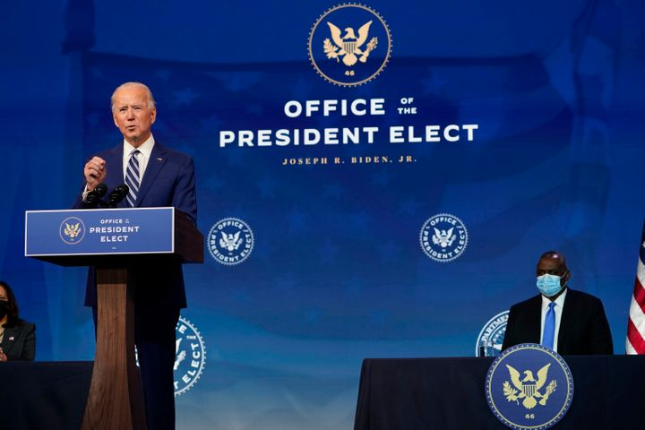 President-elect Joe Biden speaks during an event to announce his choice of retired Army Gen. Lloyd Austin, right, to be secre