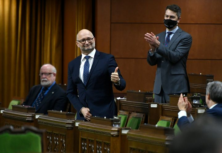 Minister of Justice David Lametti gives a thumbs up as he rises to vote in favour of a motion on Bill C-7 in the House of Commons on Parliament Hill in Ottawa on Thursday.