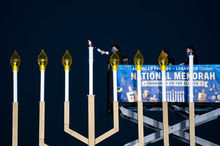 Rabbi Levi Shemtov, executive vice president of American Friends of Lubavitch, lights the National Menorah during a ceremony in President's Park just south of the White House on December 10, 2020 in Washington, DC.