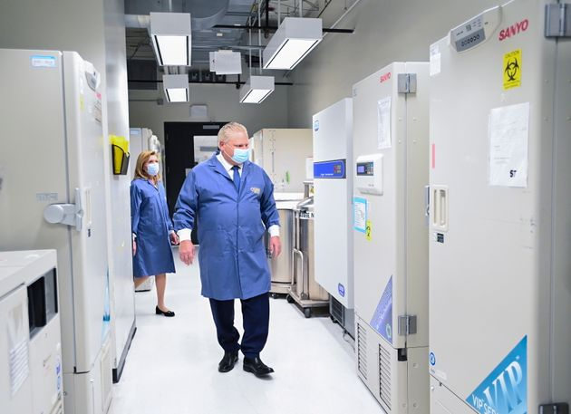 Ontario Premier Doug Ford, front, and Ontario Health Minister Christine Elliott look at freezers ahead...