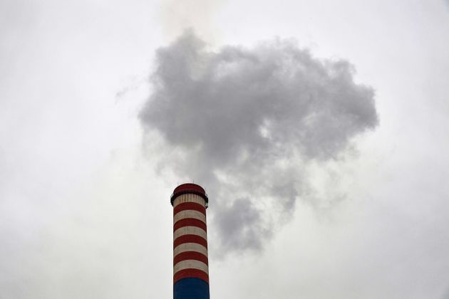 Smoke billows from a chimney at the ArcelorMittal Italia steel plant (ex Ilva) on November 7, 2019 in...
