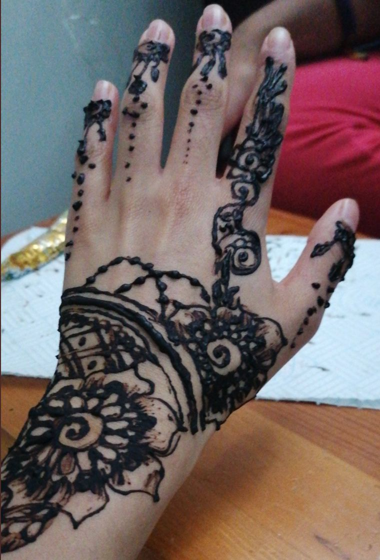 May Batul decorated her hands with henna for