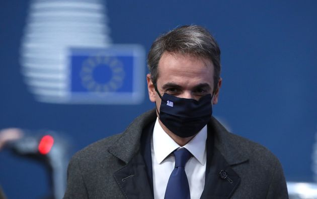Greek Prime Minister Kyriakos Mitsotakis arrives for an EU summit at the European Council building in...