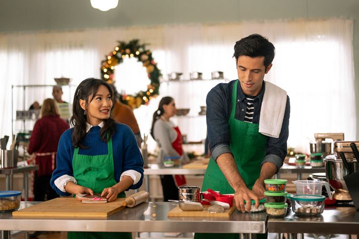 """Jacky Lai (left) and Tony Giroux (right) in a scene from Lifetime's """"A Sugar & Spice Holiday,"""" the network's first holiday ro"""