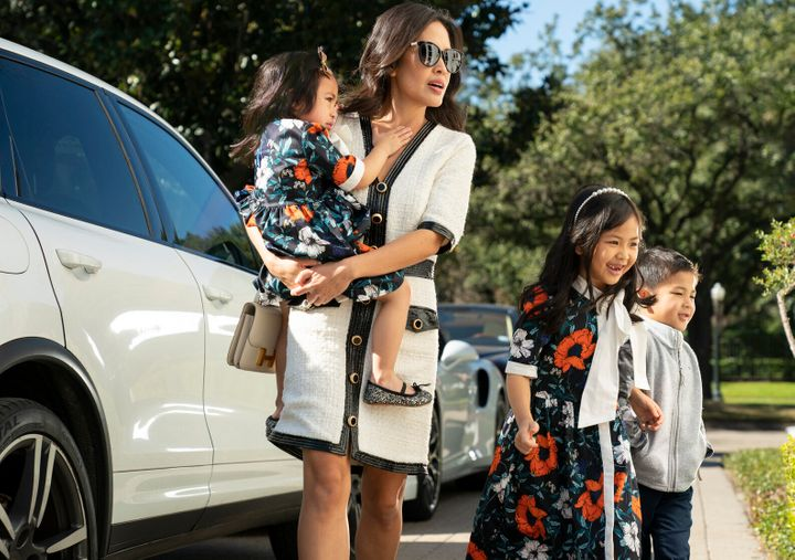 """Judy Ho (center) and her three children in a scene from HBO Max's """"House of Ho,"""" a reality series that follows the Hos, a wea"""