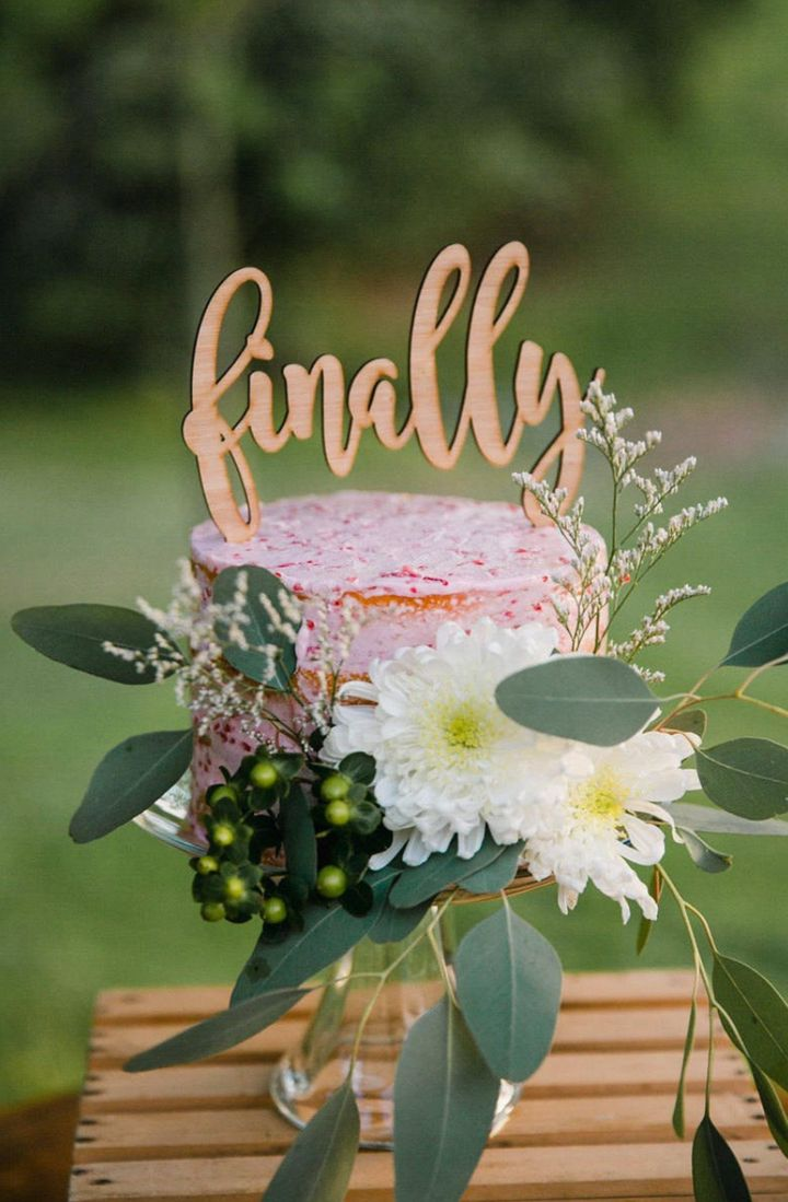 """Cake topper from <a href=""""https://www.etsy.com/uk/listing/659656780/finally-wedding-cake-topper-wedding-cake?ga_order=most_relevant&amp;ga_search_type=all&amp;ga_view_type=gallery&amp;ga_search_query=finally+cake+topper&amp;ref=sc_gallery-1-6&amp;plkey=1455d5d48d9049b5b4459ba6dc88bb284c1672f2%3A659656780&amp;col=1"""" target=""""_blank"""" rel=""""noopener noreferrer"""">RubiandLib/Etsy</a>."""