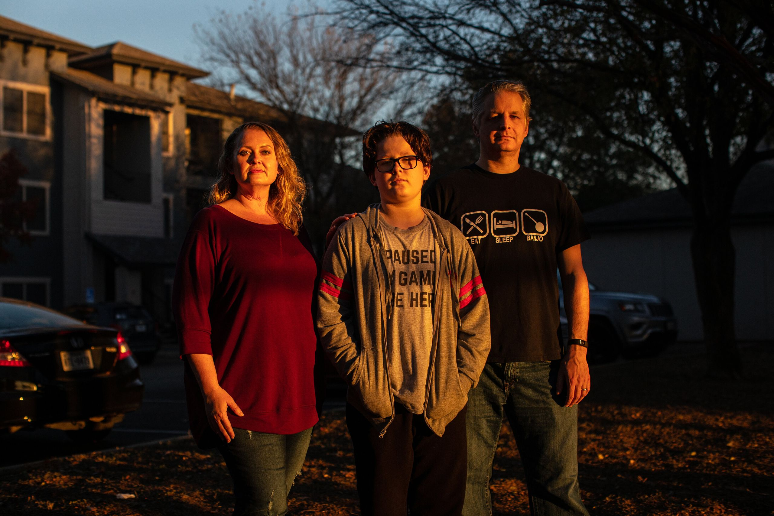 Kandis, Cooper and Rob Seaver stand for a portrait at their apartment complex in Austin, Texas, on Dec. 8, 2020.