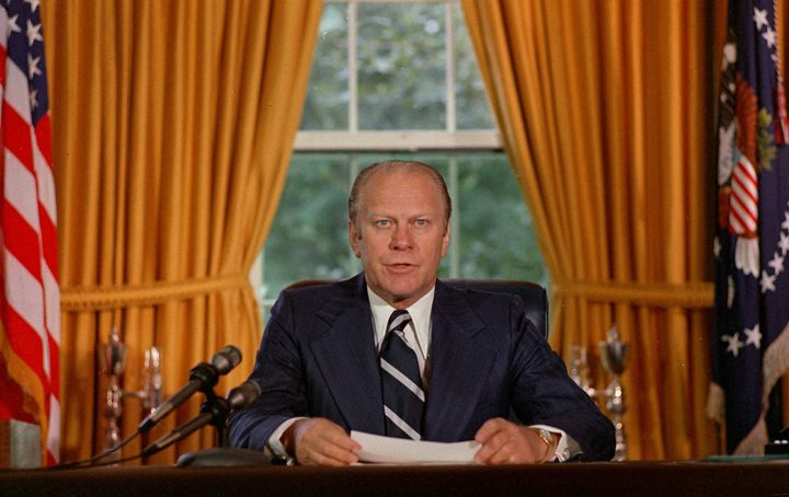 "President Gerald Ford reads a proclamation in the White House on Sept. 8, 1974 granting former president Richard Nixon ""a full, free and absolute pardon"" for all ""offenses against the United States"" during the period of his presidency."