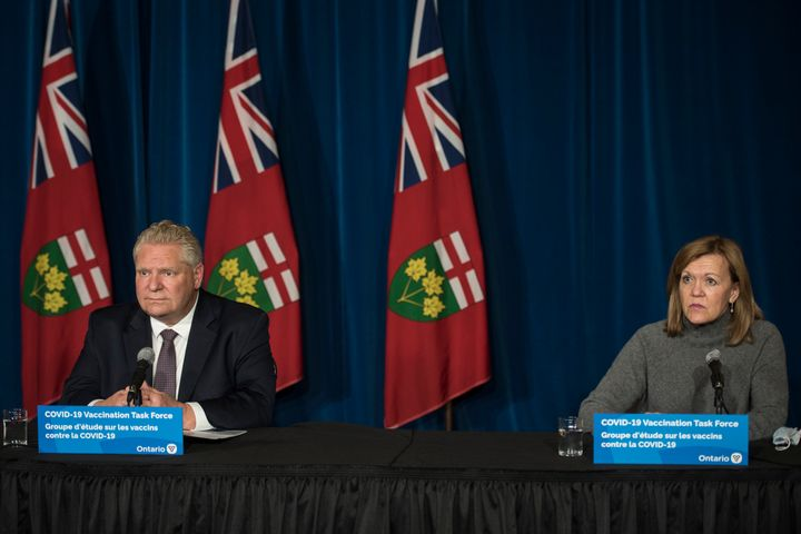Ontario Premier Doug Ford listens during a press conference at Queen's Park in Toronto on Dec. 11, 2020.