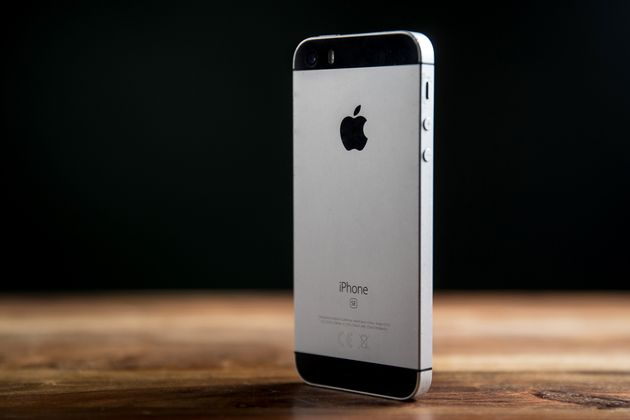 CRACOW, POLAND - 2020/12/01: In this photo illustration a Space Grey iPhone seen on a wooden desk. (Photo...