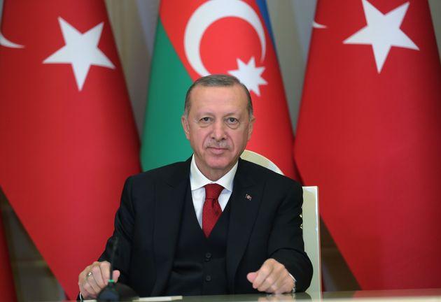 BAKU, TURKEY - DECEMBER 10: Turkish President Recep Tayyip Erdogan speaks during a joint press conference...