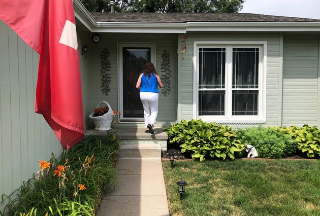 Eastman knocks on a voter's door in Omaha in July 2018. Eastman and the state Democratic Party...