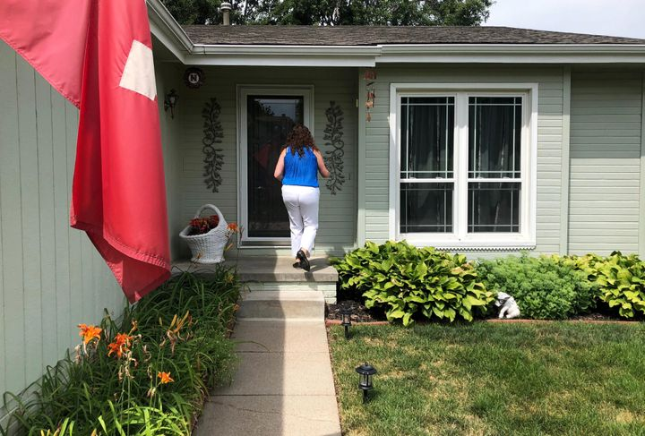 Eastman knocks on a voter's door in Omaha in July 2018. Eastman and the state Democratic Party stopped canvassing