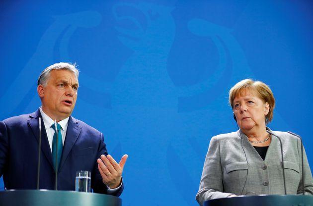 German Chancellor Angela Merkel and Hungarian Prime Minister Viktor Orban address the media at the Chancellery...