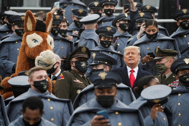 U.S. President Trump stands among U.S. Army cadets as he attends the annual Army-Navy collegiate football...