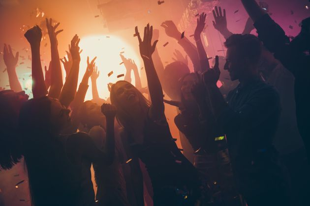 Photo of many party people buddies dancing yellow lights confetti flying everywhere nightclub event hands...