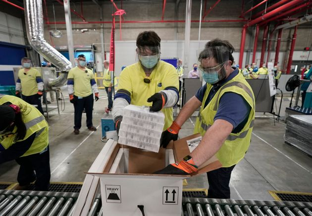 Boxes containing the Pfizer-BioNTech COVID-19 vaccine are prepared to be shipped at the Pfizer Global...