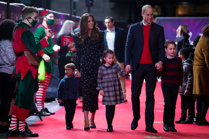 Prince William and Kate Middleton with their children Prince Louis, Princess Charlotte and Prince George at a pantomime performance at London's Palladium Theatre on Friday.