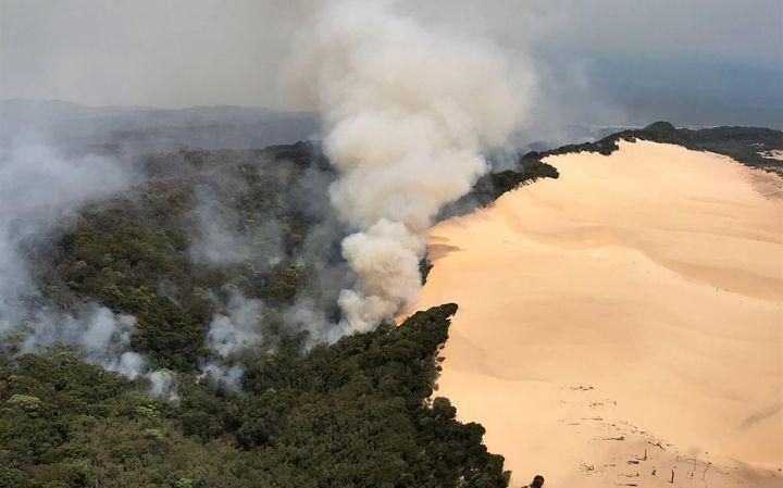 Bushfires burn on November 30, 2020 on Fraser Island, Australia. Fraser Island, also known as K'gari, is world heritage listed and the world's largest sand island.
