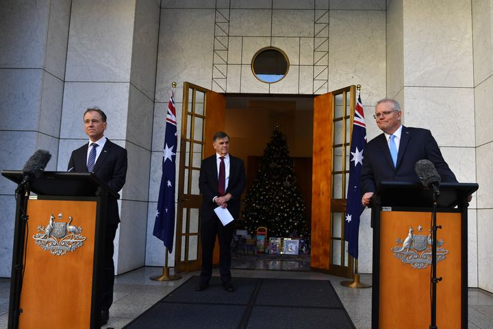 """Australia's Minister for Health Greg Hunt (left), Prime Minister Scott Morrison (right) and Australia's Chief Medical Officer Brendan Murphy (centre) during a press conference in the Prime Ministers courtyard on December 11, 2020 in Canberra, Australia. Hunt said the bubble was """"good for the economy, good for our airlines and good for both countries"""" and the first step on a return to international normality."""