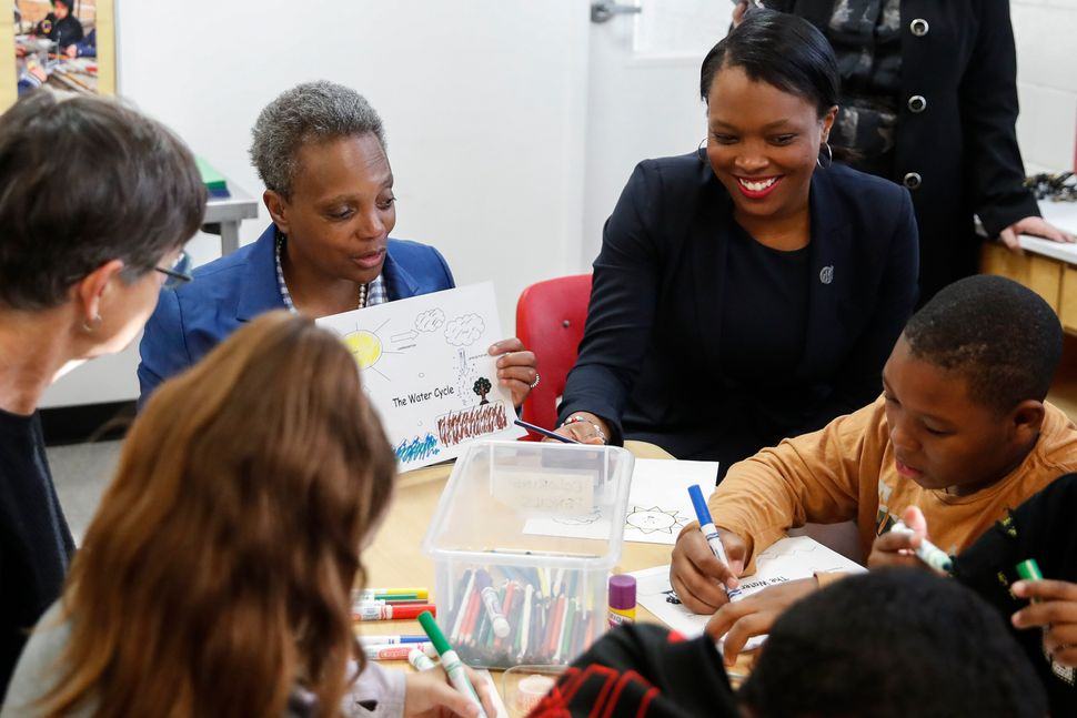 Chicago Mayor Lori Lightfoot and Chicago Public Schools CEO Janice Jackson check on students on Oct. 17, 2019 in Chicago.