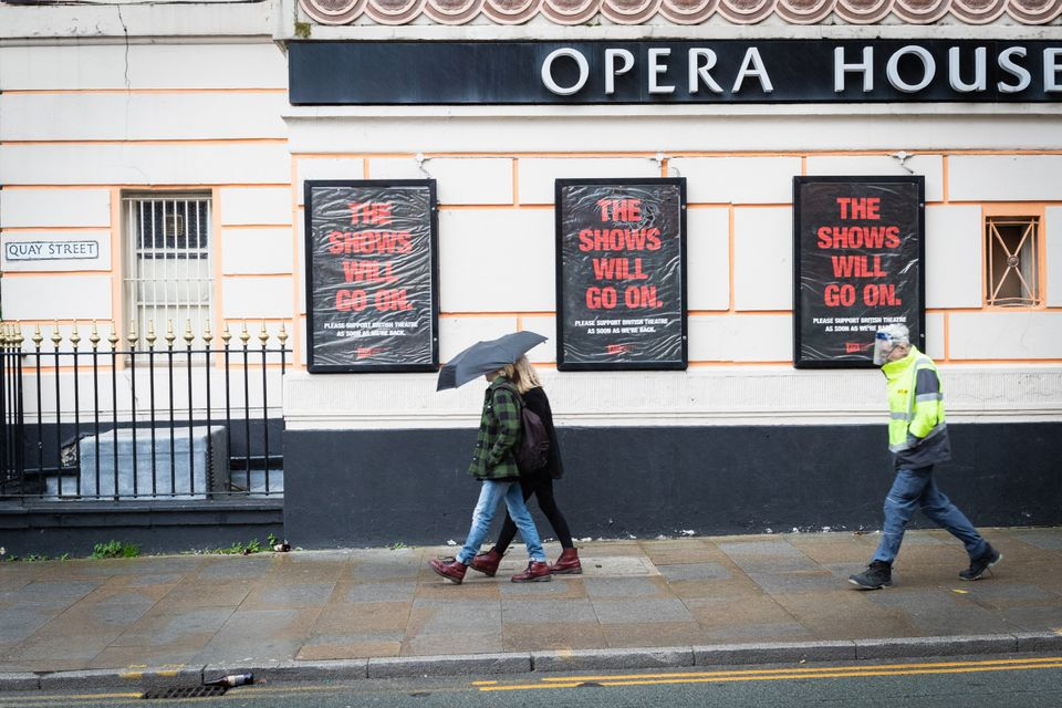 Members of the public walking past the Opera House theatre, which has been closed during Covid 19