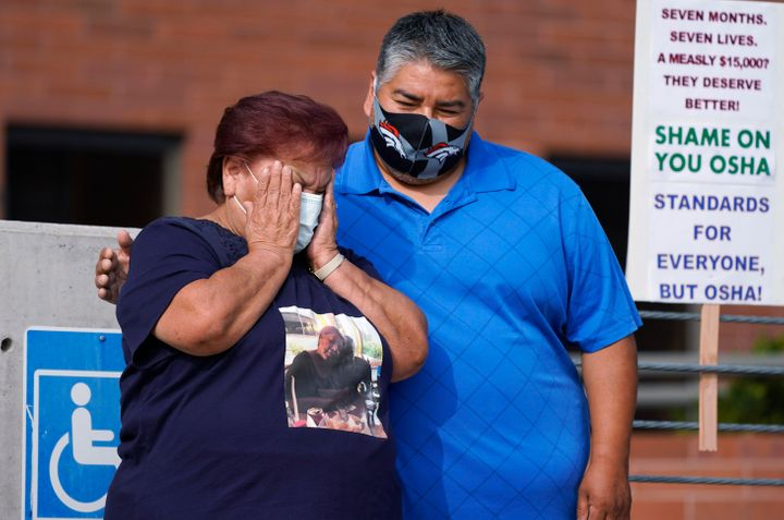 Carolina Sanchez, left, is comforted by her oldest son, Saul Jr., during a protest on  Sept. 16, 2020, in downtown Denve