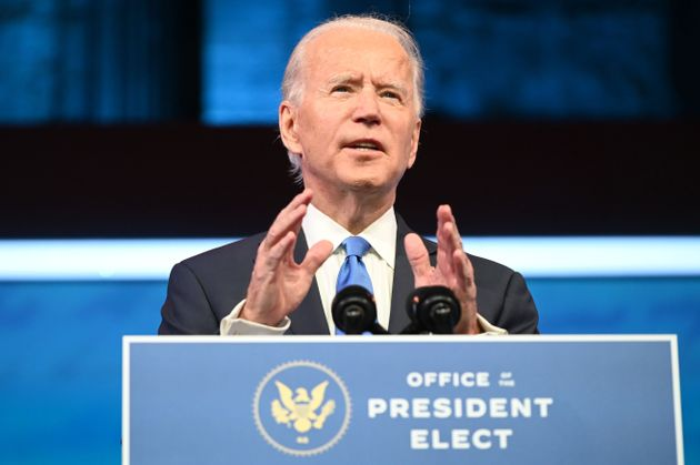 US President-elect Joe Biden delivers remarks on the Electoral college certification at the Queen Theatre...