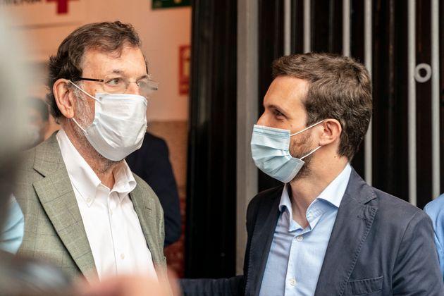 Rajoy y Casado durante la campaña de las elecciones