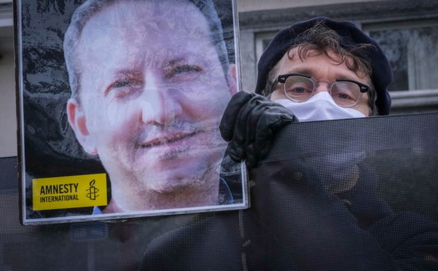 An activists protest against the death sentence of Swedish-Iranian scientist Ahmadreza Djalali, who was...