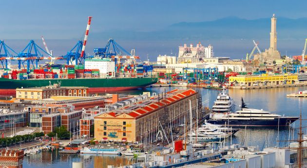 Panorama of Historical Lanterna old Lighthouse, container and passenger terminals in seaport of Genoa...