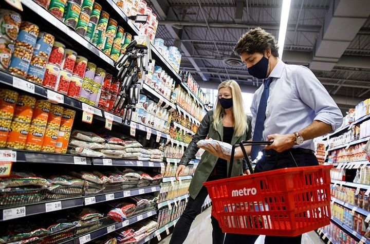 Prime Minister Justin Trudeau shops at a Metro earlier this year before dropping the items in a bin destined for a food bank.