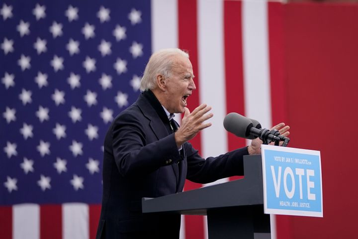 President-elect Joe Biden speaks during a drive-in rally for U.S. Senate candidates Jon Ossoff and Rev. Raphael Warnock in At
