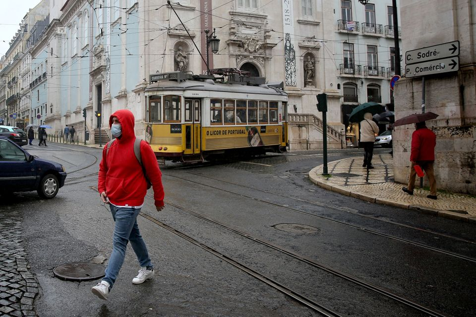 A man wearing a face mask walks in Lisbon, Portugal, on December 09, 2020. There will be no limit on...