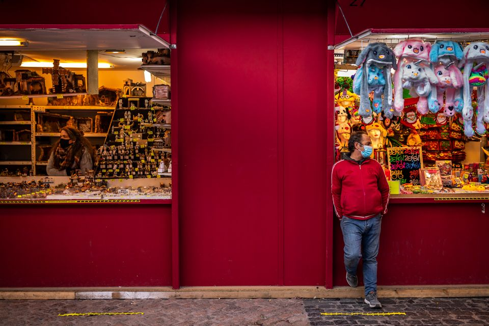 Vendors wait for customers at a Christmas market at the Plaza Mayor, Madrid, Spain.Prime minister...