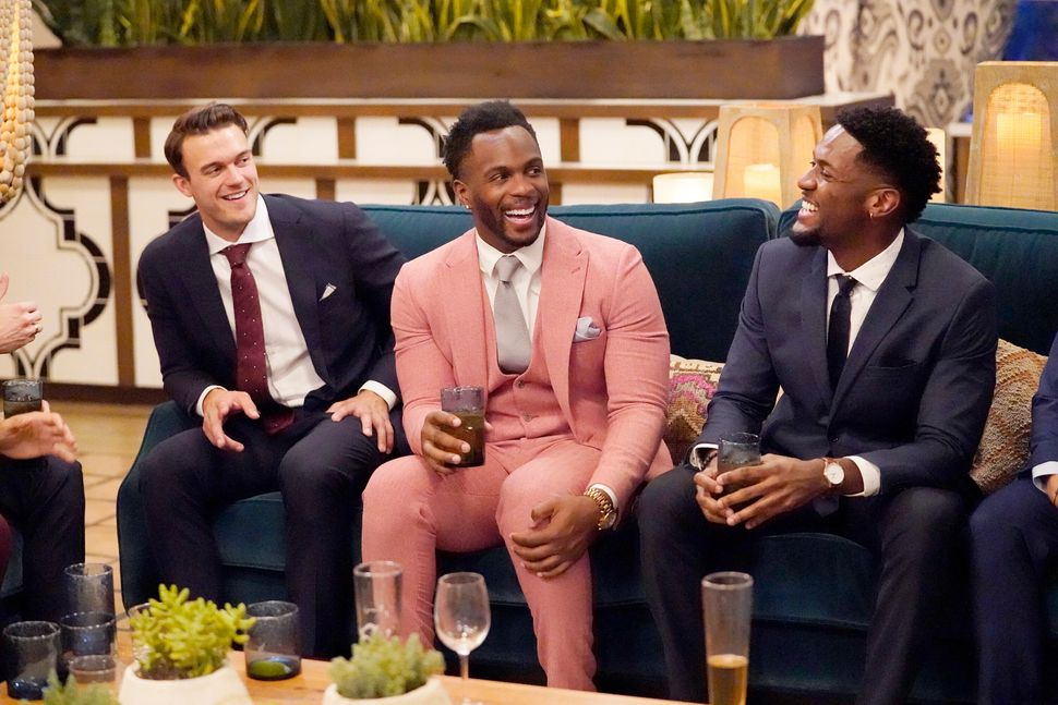 "Nwachukwu (center) with castmates Ben Smith (left) and Demar Jackson (right) on this season of ""The Bachelorette."""