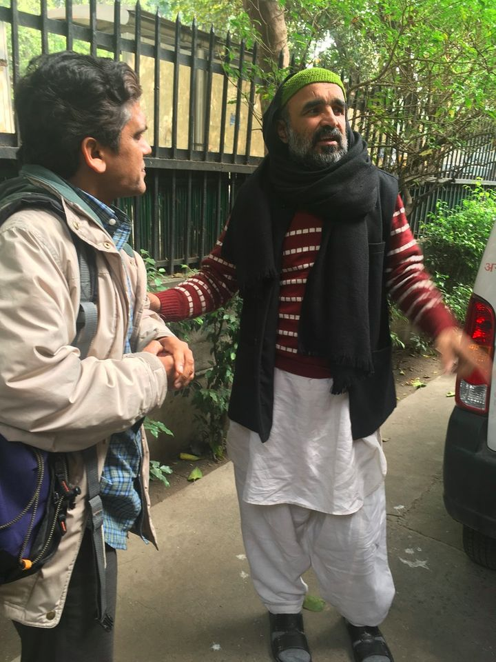 Muslim peace activist Faisal Khan (right) speaks with Hindus for Human Rights co-founder Deepak Gupta in Delhi, India, in Dec