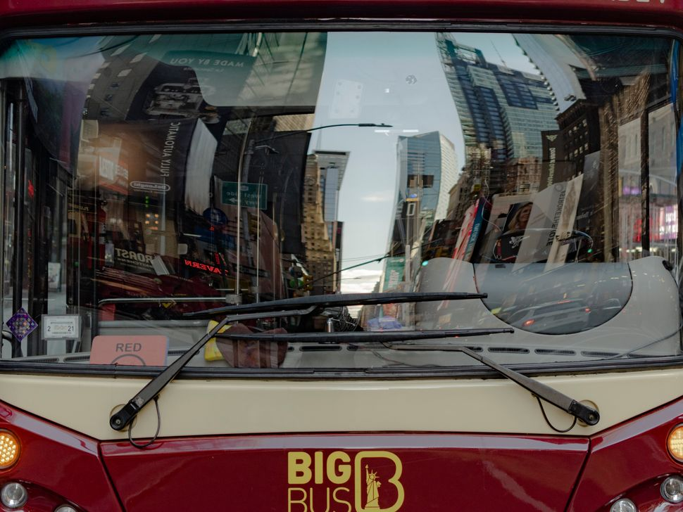 A double-decker tour bus belonging to the Big Bus tour company prepares to depart on a downtown route. The route got cut down and now only makes five stops; it would make more than 20 on a pre-pandemic tour.